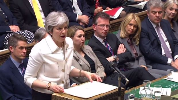 British prime minister Theresa May fields questions in the House of Commons following UK participation in air strikes on Syria. Photograph: Getty Images