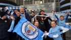 Fans  celebrate  at the Etihad Stadium on Sunday as Manchester City win the Premier League. Photograph: PA Wire