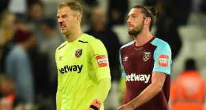 Joe Hart and Andy Carroll leave the pitch at The London Stadium. Photograph: Getty Images