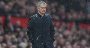 José Mourinho watches on during Manchester United's 1-0 loss to West Brom. Photograph: Laurence Griffiths/Getty