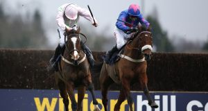 Cue Card battles Vautour en-route to victory in the 2015 King George at Kempton. Photograph: Alan Crowhurst/Getty