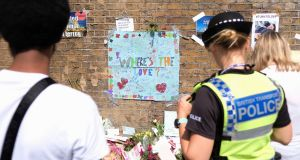 People stop to read some of the messages of support and love for the Muslim community near London's Finsbury Mosque in June 2017. Photograph: Leon Neal/Getty Images