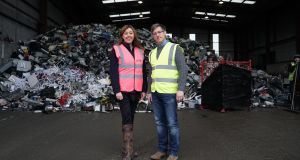 Elizabeth O'Reilly of WEEE Ireland and KMK Metals Recycling's commercial manager, Kai Meyer, at the company's plant in Tullamore.