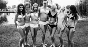 Filming Monty Python's Flying Circus in 1970, John Cleese and Mike Palin pose with five women. Photograph: Daily Mirror/Mirrorpix/Mirrorpix via Getty Images