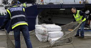Spanish customs officers and police unload a shipment of cocaine from a vessel called Riptide at the port of Vigo, northwestern Spain, in June  2013. File photograph: Miguel Riopa/AFP/Getty Images
