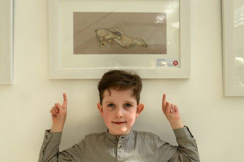 NOAH JAMES FLYNN: Third prize (€125) went to Galway student Noah James Flynn (8), from Scoil Bhride, Menlo, in his category for a painting entitled Fox Skull.  Photograph: Dara Mac Donaill/The Irish Times