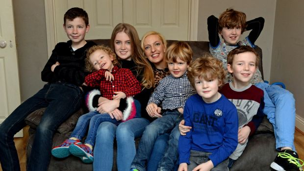 Jen Hogan with her daughter Chloe and sons, from left, Adam, Noah, Zach, Tobey, Luke and Jamie. Photograph: Cyril Byrne