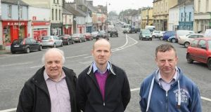Cllr Michael Mulligan, Dr Martin Garvey and Micheal Frain on The Square, with a view of Main Street, Ballaghaderreen, Co Roscommon. Photograph; Mick McCormack