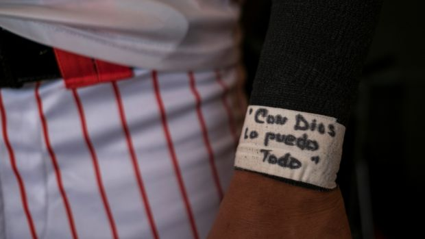 "A Cayey Toritos player's message reads ""With God I can do it all"". Photograph: Dennis M Rivera Pichardo/The New York Times"