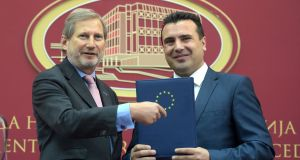 Macedonian prime minister Zoran Zaev (right) accepts the European Commission report from EU commissioner Johannes Hahn, on Wednesday. Photograph: Nake Batev/EPA