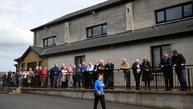 Big Tom: people queue to pay their respects at Oram Gaelic Football Club. Photograph: Brian Lawless/PA Wire
