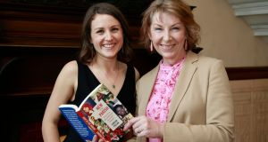 Irish Times journalist Sorcha Pollak with RTÉ broadcaster Aine Lawlor at the launch of her book  New to the Parish: Stories of Love War and Adventure from Ireland's Immigrants. Photograph: Nick Bradshaw