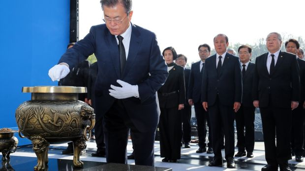 South Korean president Moon Jae-in burns incense at a national cemetery in northern Seoul, South Korea, on Thursday to mark the anniversary of the 19 April Revolution, a popular pro-democracy and anti-dictatorship uprising in 1960. Photograph: EPA/Yonhap