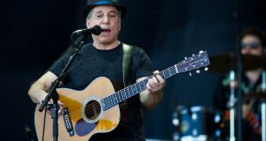 Shazam for tickets: Paul Simon, who plays the RDS Arena in July, seem performing at the 2011 Glastonbury Festival. Photograph: Ian Gavan / Getty Images