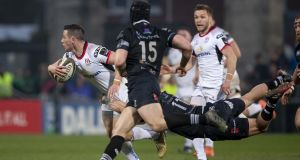 Ulster's John Cooney in action against Ospreys – injuries saw the scrumhalf moved to outhalf during the game. Photograph: Morgan Treacy/Inpho
