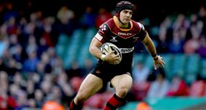 Newport Gwent Dragons' Adam Hughes has been forced to retire due to a brain injury. Photograph: James Crombie/Inpho