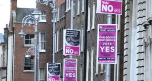 Abortion Referendum posters outside Government Buildings on  Merrion Street. Photograph: Cyril Byrne / THE IRISH TIMES
