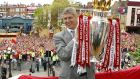 Arsène Wenger with the Premiership trophy after Arsenal's unbeaten 2003/04 campaign. Photograph: PA