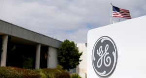 GE earned an adjusted 16 cents per share, up from a restated 14 cents a share a year earlier