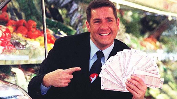 "Dale Winton doing a ""Supermarket Sweep"" in Brent Cross, London, to promote the UK national lottery in 1997. Photograph: Tony Harris/PA Wire"