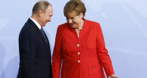 Russian president Vladimir Putin and German chancellor Angela Merkel.  Merkel has announced plans to meet Putin 'in the foreseeable future'. Photograph: Getty Images