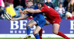 Leinster's Jordan Larmour in action with  Ryan Elias of Scarlets in February 2018. Photograph: Byran Keane/Inpho