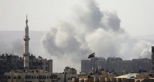 Smoke rises from the Yarmouk Palestinian refugee camp in Damascus on Friday. Photograph: Ali Hashisho/Reuters