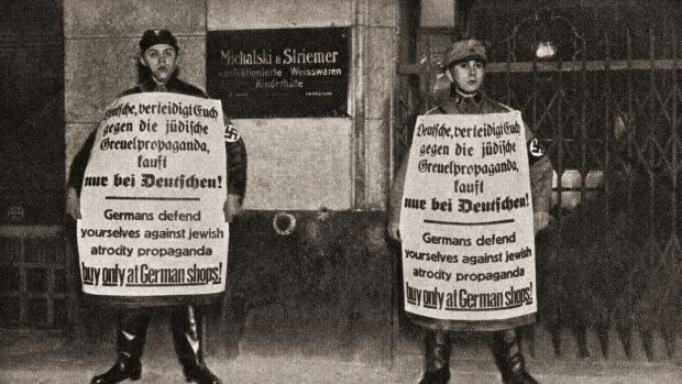 Two soldiers holding anti-Jewish propaganda in Berlin, Germany in 1933. Photograph: Universal History Archive/UIG via Getty Images