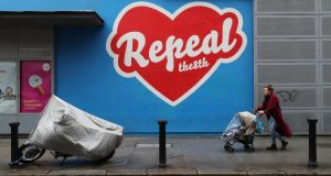 "A mural featuring a red heart on a blue background, with ""Repeal the 8th"" written across it, outside the Project Arts Centre in Dublin. File photograph: Niall Carson/PA Wire"