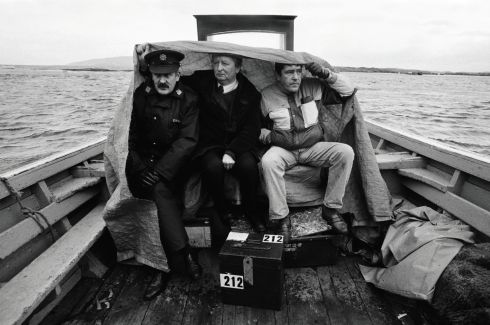 Garda Jim Brennan; David Alcorn, the presiding officer; and Donal  Dufaigh, a radio reporter, return from Inishfree Island to Burtonport, Co Donegal, with the General Election ballot box, containing two votes, in November 1992.PHOTOGRAPH BY Frank Miller THE IRISH TIMES    BEYOND THE MOMENT