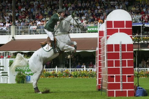 "Ireland's Cian O'Connor on his way to victory riding ""Irish Independent Casper"" in the Puissance Compedtition at the Kerrygold Dublin Horse Show in the RDS in Dublin on Saturday. Photograph by Frank Miller 10.8.02"