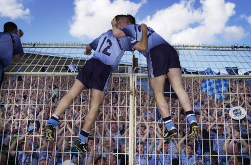 Senan Connell, left, and Tom Mulligan celebrate the return of the Dubs in front of fans on Hill 16  after their victory over Kildare in the Leinster Football Championship at  Croke Park. Photograph: Frank Miller 14.7.02