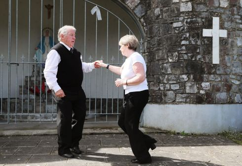FUNERAL JIVE: Pat McShane, originally from Castleblayney, and Marian Quigg, originally from Derry, both now living in Wolverhampton, jive as a sing-song is belted out on the grounds of Saint Patrick's Church. Photograph: Brian Lawless/PA Wire