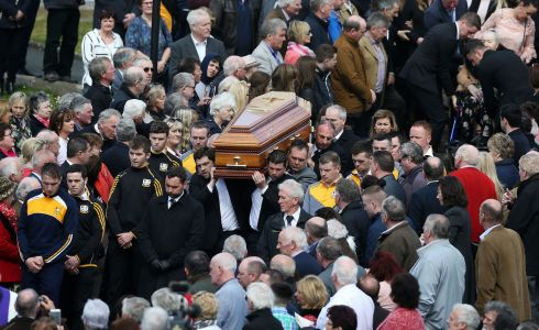 SHOULDER-HIGH: Big Tom's coffin is carried from St Patrick's Church after the funeral service.  Photograph: Brian Lawless/PA Wire