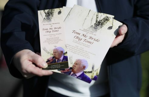 MASS BOOKLETS: A woman holds funeral Mass booklets outside Saint Patrick's Church. Photograph: Brian Lawless/PA Wire
