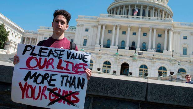 Amit Dadon, a graduate in 2017 from Marjory Stoneman Douglas High School, poses on the West Lawn of the US Capitol after rallying with several hundred students to call for stricter gun laws in Washington, DC, on Friday, April 20th, 2018. Photograph: Andrew Caballero/AFP/Getty Images