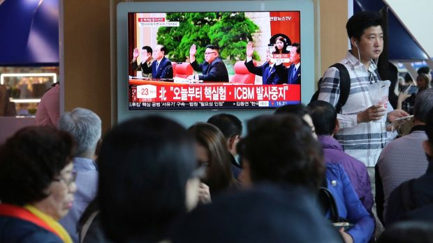 People watch a news programme in Seoul featuring North Korean leader Kim Jong Un announcing he had suspended nuclear and long-range missile tests. Photograph: Ahn Young-joon/AP