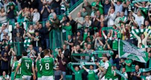 Hibernian players celebrate in front of their fans after the match. Photograph: Russell Cheyne/Inpho
