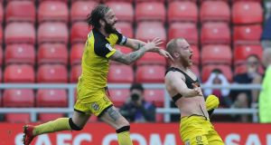 Liam Boyce (right) of Burton Albion celebrates scoring during the Sky Bet Championship match against  Sunderland  at the  Stadium of Light. Photograph: Nigel Roddis/Getty Images