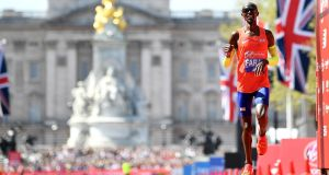 Mo Farah of Britain crosses the finish line to take third place during the Virgin Money London Marathon. Photo: Justin Setterfield/Getty Images