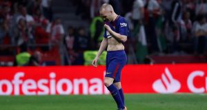 An emotional Andres Iniesta walks off the pitch after being substituted in Barcelona's Copa del  Rey final win over Sevilla at the Wanda Metropolitano stadium in  Madrid. Photograph: Juan Medina/Reuters