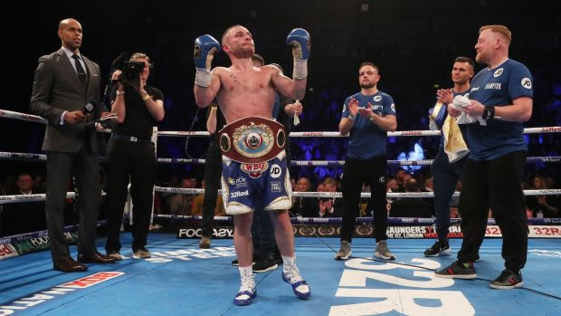 Carl Frampton celebrates winning the WBO Interim World Featherweight Championship Bout against Nonito Donaire. Photograph: Brian Lawless/PA Wire.