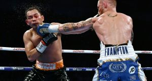 Carl Frampton lands a left to the jaw of  Nonito Donaire during their WBO Interim World Featherweight championship bout at the SSE Arena  in Belfast. Photograph: Charles McQuillan/Getty Images