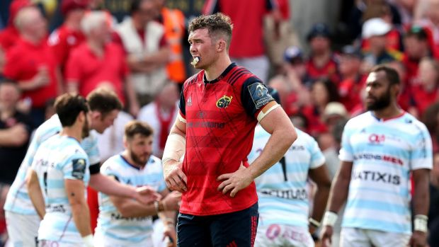 Munster captain Peter O'Mahony looks on as Racing 92 celebrate scoring a try in the Champions Cup semi-final at Stade Chaban-Delmas. Photograph: Billy Stickland/Inpho