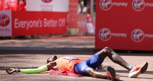 Mo Farah reacts after crossing the finish line to finish third in the London Marathon. Photo: Daniel Leal-Olivas/Getty Images