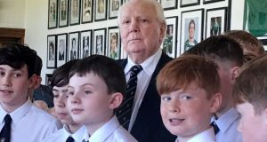Former INM majority shareholder Sir Anthony O'Reilly and pupils from Belvedere College choir at an event held in his honour at Old Belvedere Rugby Club on Saturday. Photograph: Conor Pope