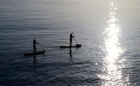 ON BOARD: Paddle-boarders enjoy the calm conditions off Greystones, Co Wicklow. Photograph: Nick Bradshaw