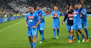Napoli's Allan celebrates after the match with team-mates  at the Allianz Stadium in Turin. Photograph: Massimo Pinca/Reuters