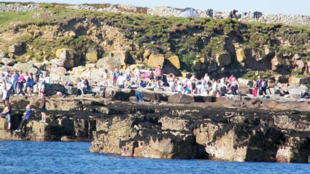 Visitors to Inishmurray Island, Co Sligo. Photo supplied with permission from Keith Clarke