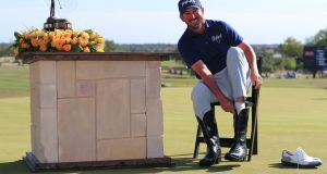 Andrew Landry puts on the Champion's Boots after winning the Valero Texas Open in San Antonio. Photograph: Tom Pennington/Getty Images